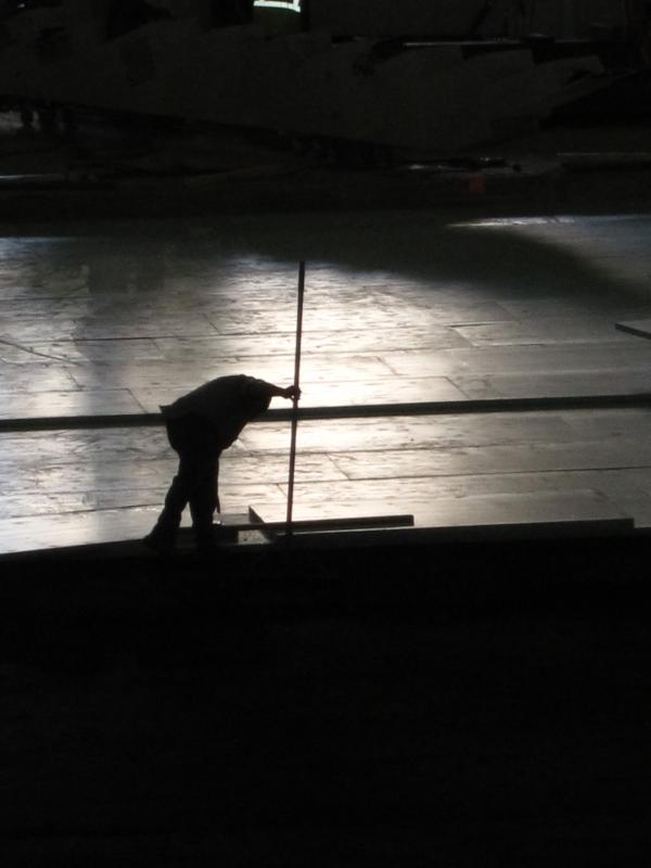 Worker installs ice rink sub-floor.